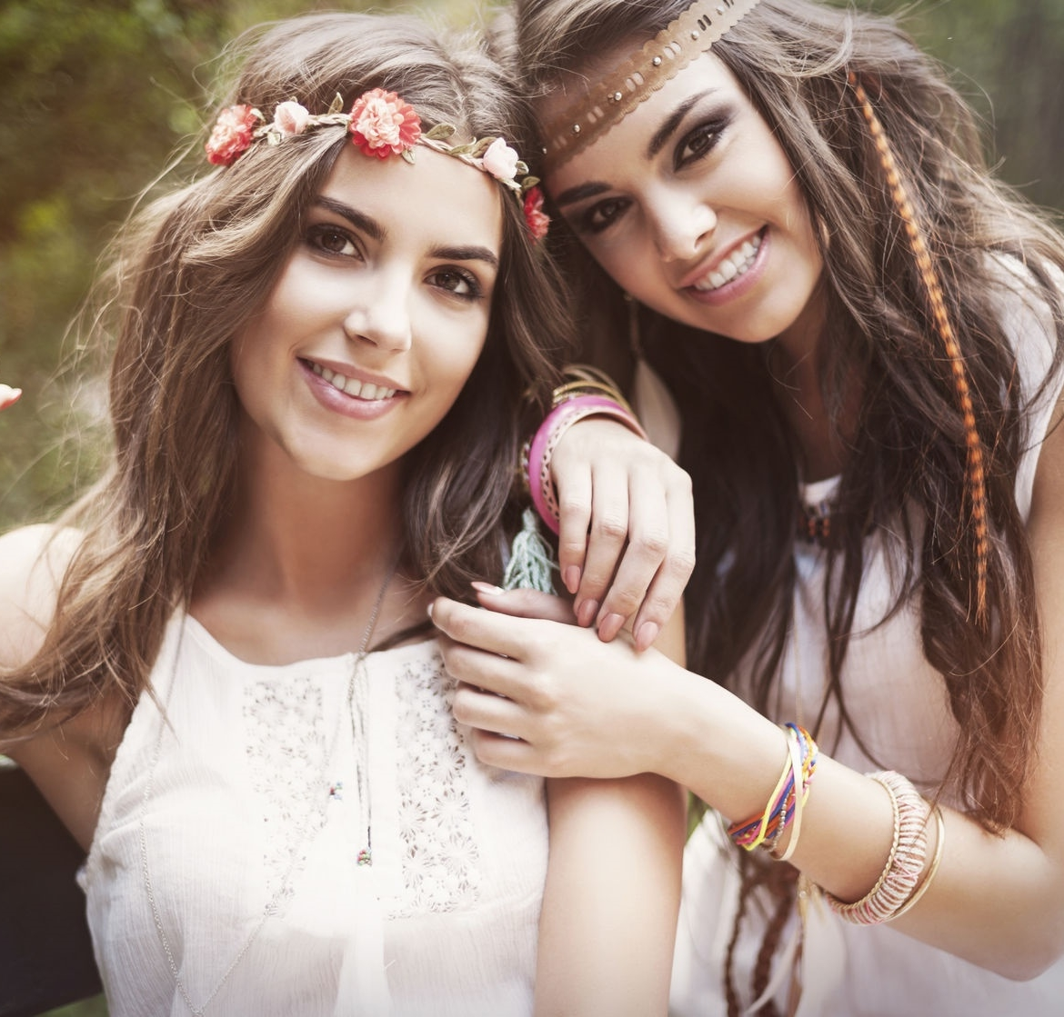two girls at a festival wearing boho rompers