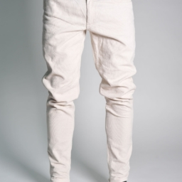 man from the waist down wearing white jeans