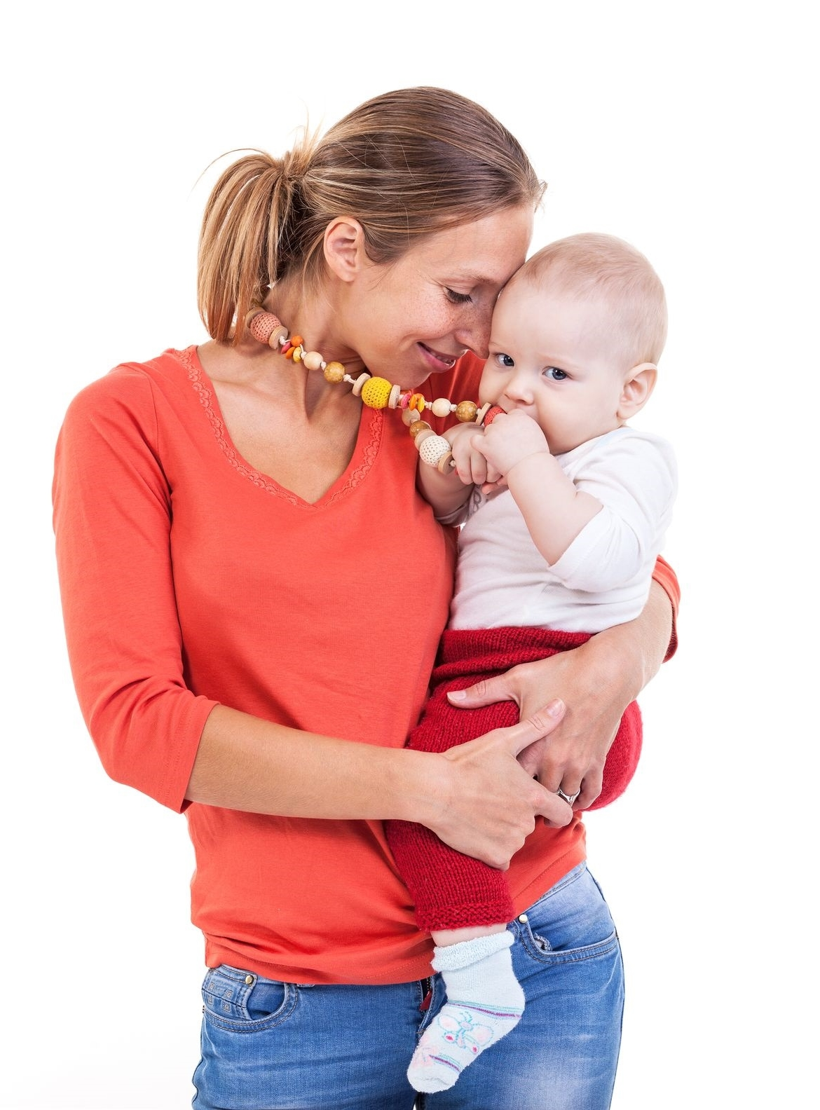 mom holding her baby and wearing a teething necklace