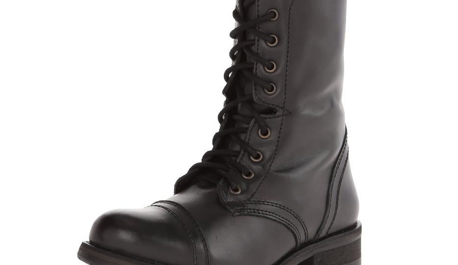 steve madden black combat boot on white background