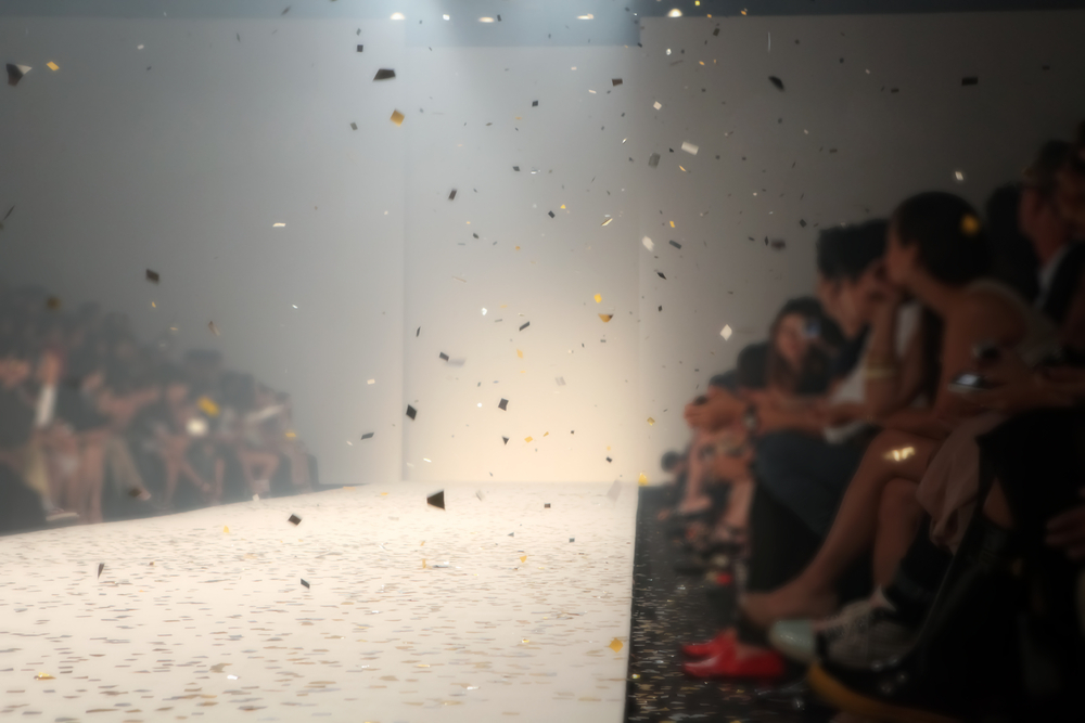 Blurred out picture of a fashion catwalk.