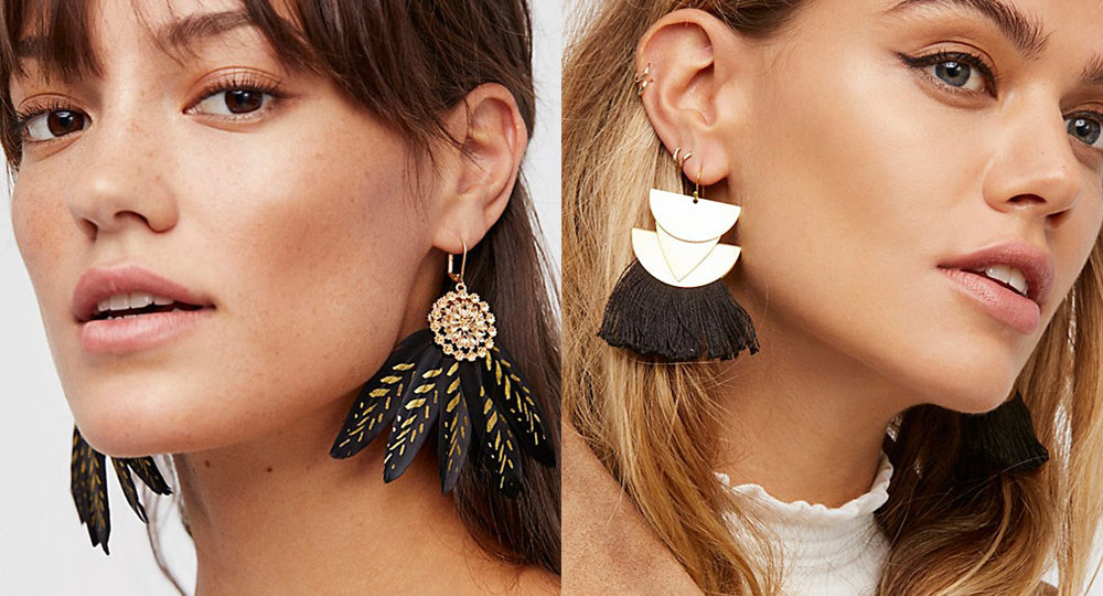 Two women wearing statement earrings for the holidays