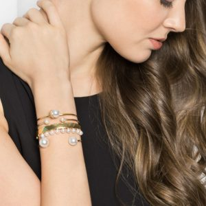 Photo courtesy of: www.baublebar.com/product/21314-snowball-pearl-cuff.html