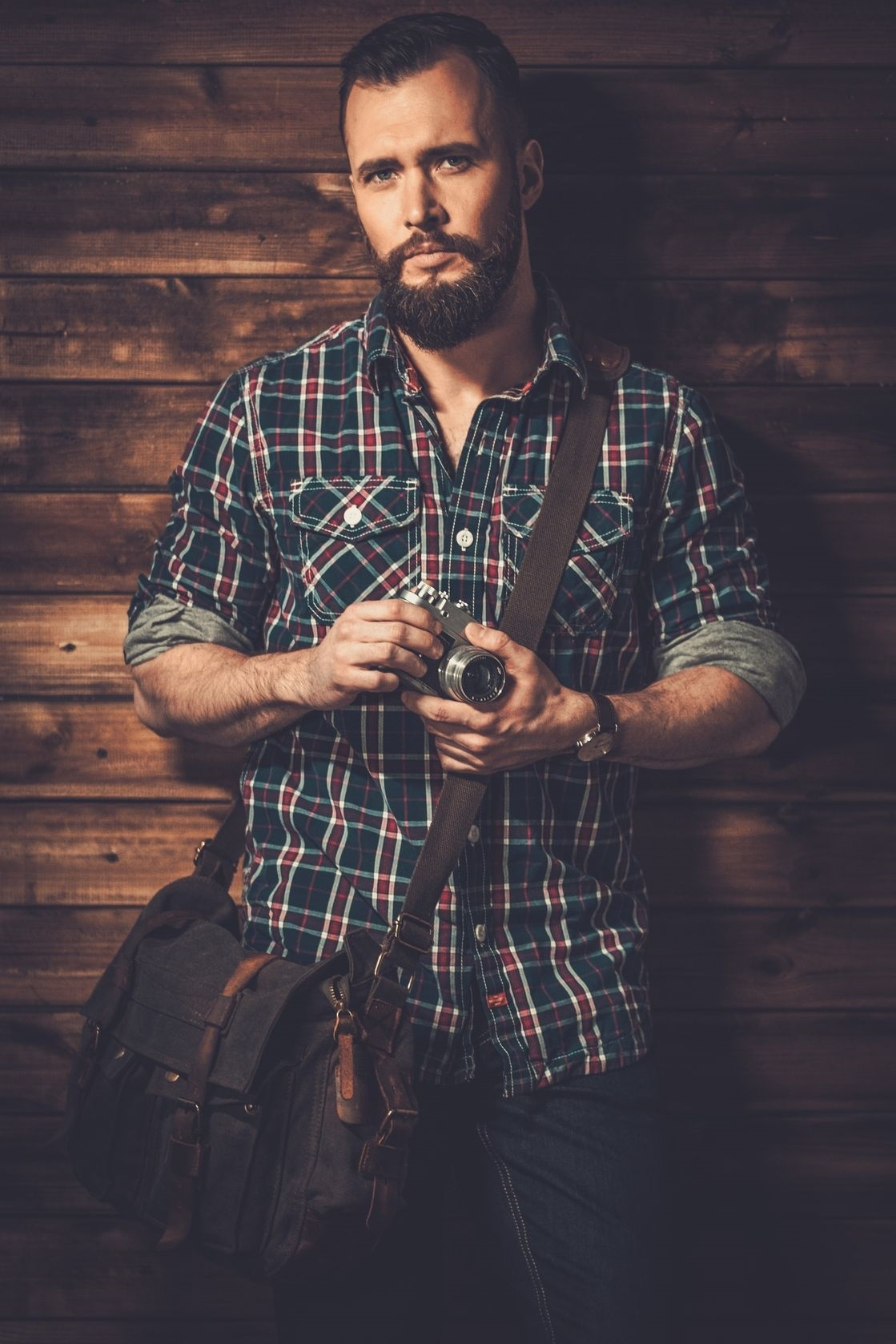 man with messenger bag and camera