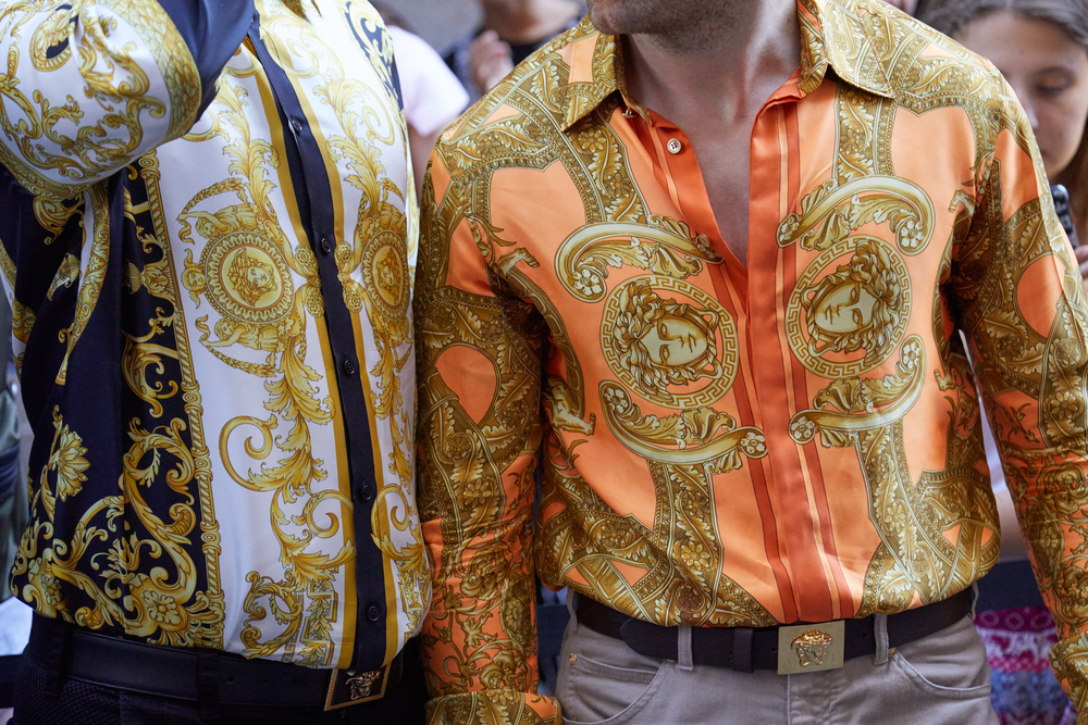 Two men in Versace printed shirts